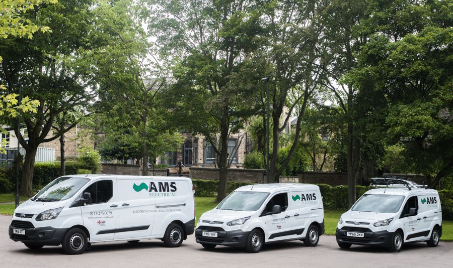Three AMS Electrical vans lined up