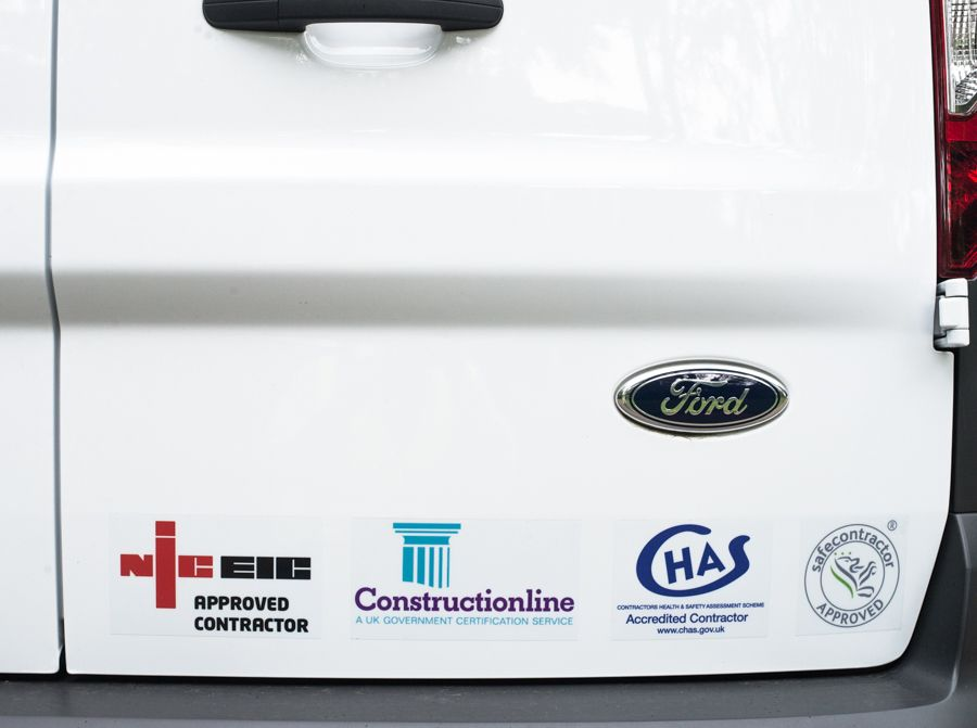 The back of an AMS Electrical van showing the logos: NICEIC, Constructionline, CHAS and safe contractor