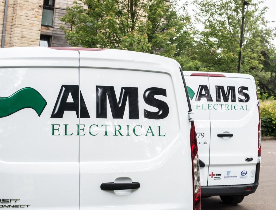 The back of two AMS Electrical vans lined up