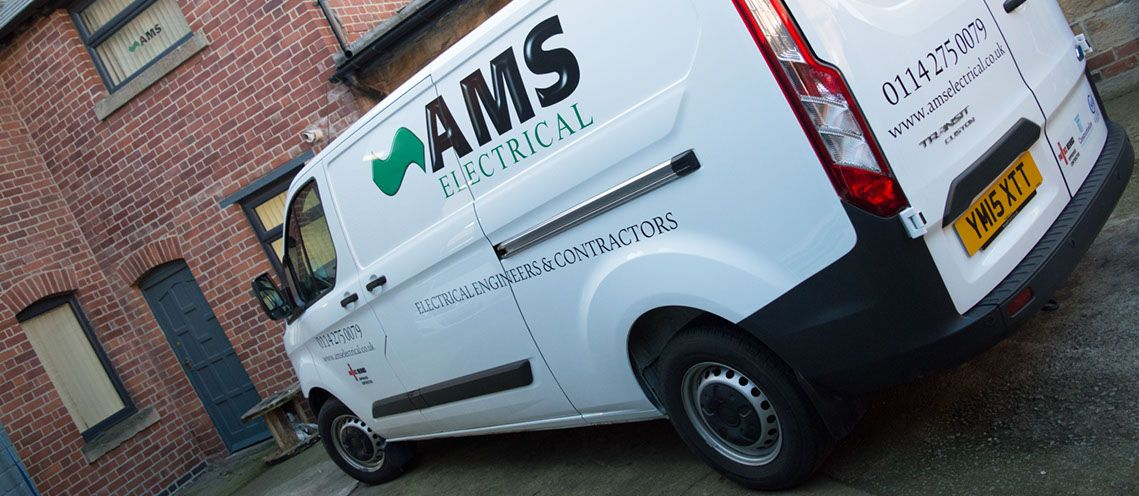 A side shot of an AMS Electrical van